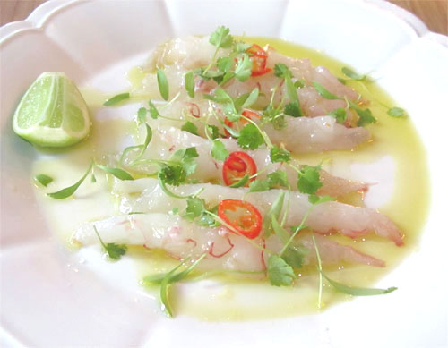 split sashimi scampi with chilli, micro leaves and sea salt flakes