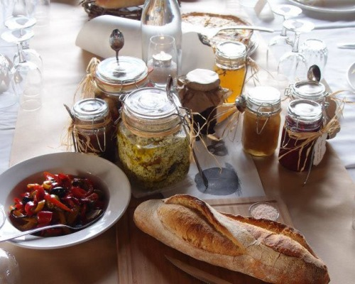 The table was overflowing with local cheeses, home made breads, preserves and relishes
