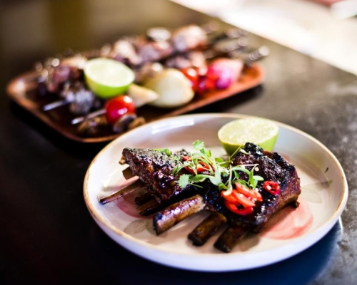 Crispy lamb short ribs with honey, chilli, caramel and lime