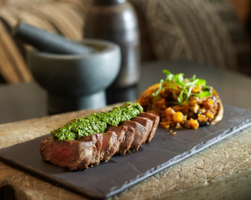 Chargrilled Black Angus sirloin with quinoa, black bean, pumpkin and green chimichurri